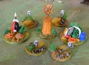 Divers articles prévus dans les scénarii : le buisson aux offrandes, le masque d'or, le trésor, les repères à tête de mort.